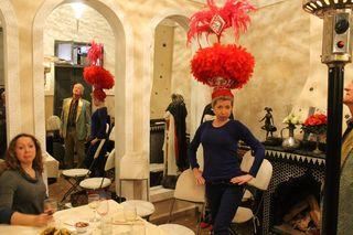 Wearing a Casino de Paris headdress
